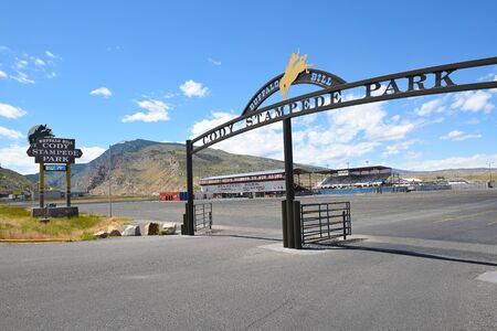 CODY, WYOMING - JUNE 24, 2017: Cody Stampede Park entrance arch and arena. Cody is the Rodeo Capitol of the World. 2017 marks 79th anniversary of nightly performances.