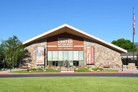 cody: CODY, WYOMING - JUNE 24, 2017: Buffalo Bill Center of the West Main Entrance. A complex of five museums and a research library featuring natural history, art and artifacts of the American West.