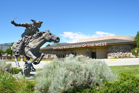 CODY, WYOMING - JUNE 24, 2017: Horse and Rider statue at Buffalo Bill Center of the West. A complex of five museums and a research library featuring natural history, art and artifacts of the American West.
