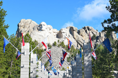 mount rushmore: KEYSTONE, SOUTH DAKOTA - JUNE 23, 2017: Mount Rushmore National Memorial. Avenue of Flags with the monument in the distance.