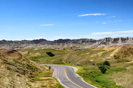 Road through the Yellow Mounds area of Badlands National Park, South Dakota. Stock Photo