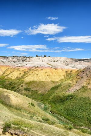 prairie: The Yellow Mounds area of Badlands National Park. The mounds are an example of a fossil soil, or paleosol.