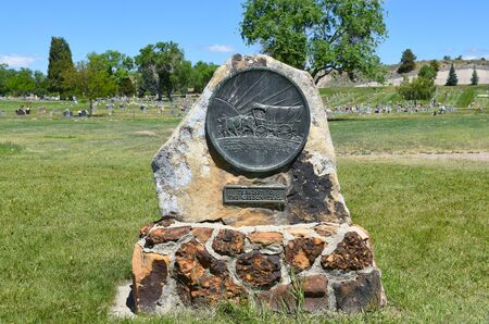 NEWCASTLE, WYOMING - JUNE 23, 2017: Oregon Trail Memorial at the Anna Miller Museum. The museum is housed in the Army National Guard Cavalry Stable, the last calvary stable in Wyoming. Editorial