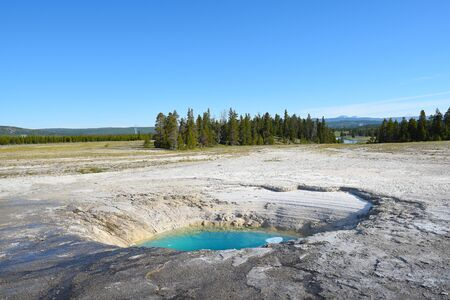 Opal Pool is a hot spring in the Midway Geyser Basin of Yellowstone National Park, Wyoming
