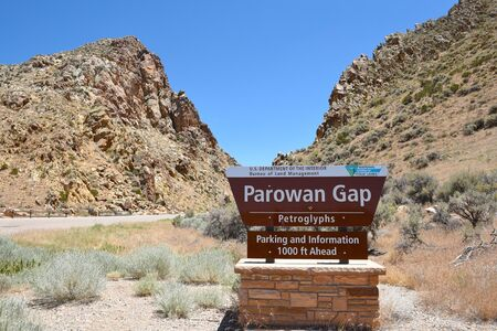 PAROWAN, UTAH - JUNE 29, 2017: Parowan Gap Sign. At the edge of the dry Little Salt Lake, lies a natural gap in the mountains, covered with hundreds of petroglyphs and dinosaur tracks.