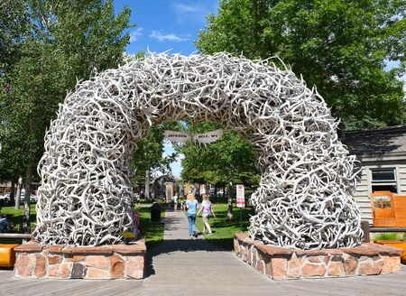 JACKSON HOLE, WYOMING - JUNE 26, 2017: Town Square Antler Arch. There is an elk antler arch at the of the four corners of the square. It takes about 2,000 antlers to build one arch.