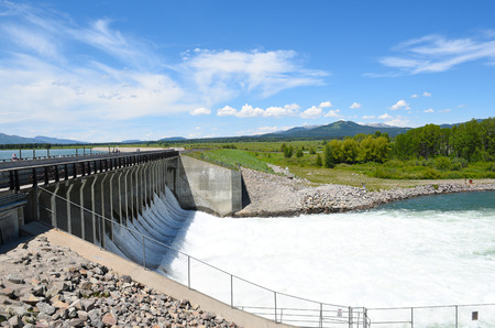 JACKSON HOLE, WYOMING - JUNE 26, 2017: Jackson Lake Dam. Built in 1911 in Grand Teton National Park, it has enlarged the natural lake that is primarily fed by the Snake River. Editorial