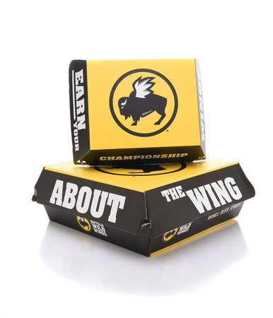 IRVINE, CALIFORNIA - JULY 10, 2017: Buffalo Wild Wings Take-Out Boxes. The chain is best known for Buffalo-style chicken wings along with over a dozen dipping sauces. Stock Photo - 81982077