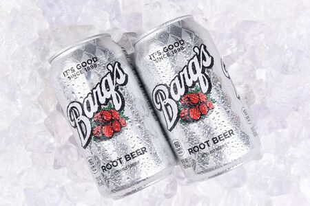 IRVINE, CALIFORNIA - JULY 10, 2017: Two Barqs Root Beer Cans on a bed of ice with condensation. Created by Edward Barq and still owned by the Barq family but bottled by the Coca-Cola Company. Editorial