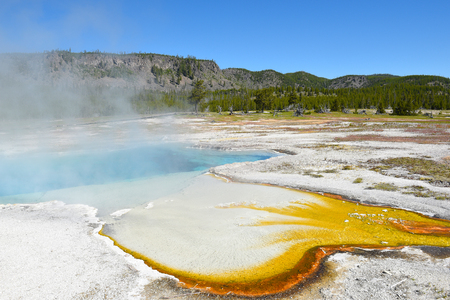 Sapphire Pool, named for its blue, crystal-clear water and for its resemblance to an Oriental sapphire. In the Biscuit Basin area of Yellowstone National Park.
