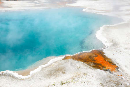 Black Pool Hot Spring in the West Thumb Geyser Basin in Yellowstone National Park. Stock Photo