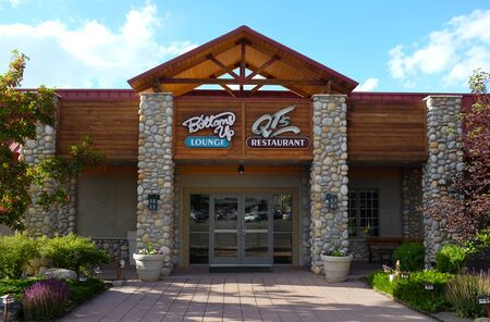 CODY, WYOMING - JUNE 24, 2017: Lounge and restaurant at the Holiday Inn Buffalo Bill Village. Buffalo Bill Village offers an authentic experience steeped in the history and legends of Cody.