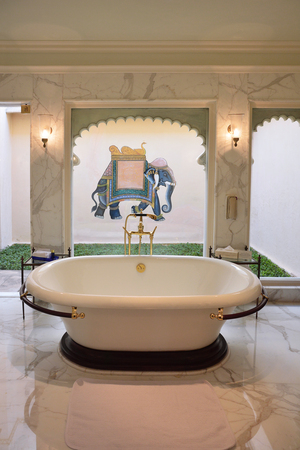 UDAIPUR, INDIA - JANUARY 21, 2017: Bathroom at the Oberoi Udaivilas Hotel suite. Located on the bank of Lake Pichola the hotel has over fifty acres, which includes a twenty-acre wildlife sanctuary.