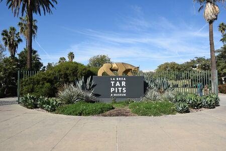 LOS ANGELES - NOVEMBER 24, 2017: The La Brea Tar Pits entrance sign. The Tar Pits and Hancock Park are situated within what was once the Mexican land grant of Rancho La Brea.