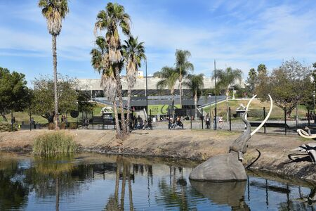LOS ANGELES - NOVEMBER 24, 2017: Lake Pit at the La Brea Tar Pits.  Pleistocene mammoth statues depict how animals became trapped in the tar. Editorial