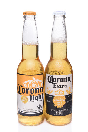 IRVINE, CALIFORNIA - DECEMBER 14, 2017: Two Bottles of Corona Beer, Light and Extra. Corona is the most popular imported beer in the USA.