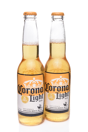 IRVINE, CALIFORNIA - DECEMBER 14, 2017: Two Bottles of Corona Light Beer. Corona is the most popular imported beer in the USA.