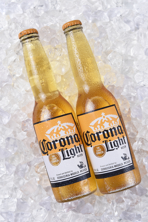 IRVINE, CALIFORNIA - DECEMBER 15, 2017: Two bottles of Corona Extra Beer on ice. Corona is the most popular imported beer in the USA.
