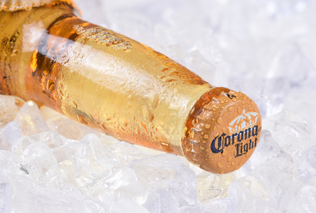 IRVINE, CALIFORNIA - DECEMBER 15, 2017: A bottle of Corona Light Beer on ice. Corona is the most popular imported beer in the USA. Editorial