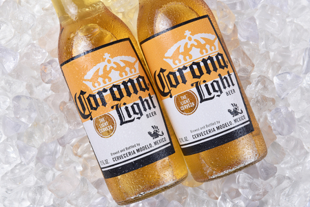 IRVINE, CALIFORNIA - DECEMBER 15, 2017: Two bottles of Corona Light Beer on ice. Corona is the most popular imported beer in the USA.