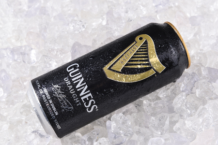 IRVINE, CA - December 15, 2017: A can of Guinness Draught on a bed of ice. The Irish beer is one of the worlds most successful beer brands with annual sales over 850 million liters.