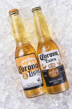 IRVINE, CALIFORNIA - DECEMBER 15, 2017: Two bottles of Corona Extra and Light Beer on ice. Corona is the most popular imported beer in the USA.