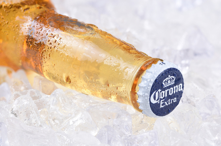 IRVINE, CALIFORNIA - DECEMBER 15, 2017: A bottle of Corona Extra Beer on ice. Corona is the most popular imported beer in the USA. 報道画像