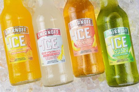 IRVINE, CA - JANUARY 4, 2018: Smirnoff Ice Green Apple and Screwdriver. The Original Premium Flavored Malt Beverage with a delightfully crisp, citrus taste.
