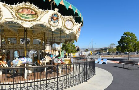 IRVINE, CA - JANUARY 31, 2018: Great Park Carousel closeup. Vintage airplane, Hangar and Soccer Stadium are int eh background.