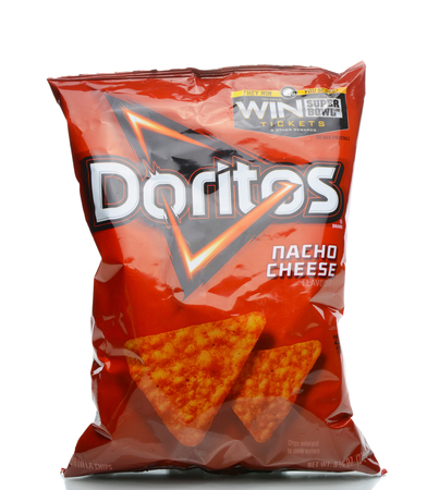 IRVINE, CALIFORNIA - JANUARY 4, 2018: Doritos Nacho Cheese Chips. Flavored tortilla chips produced since 1964 by Frito-Lay, a subsidiary of PepsiCo.