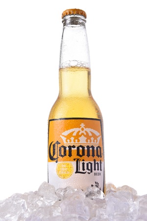 IRVINE, CALIFORNIA - MARCH 12, 2018: A bottle of Corona Light Beer in ice. Corona is the most popular imported beer in the USA.