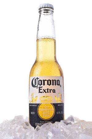 IRVINE, CALIFORNIA - MARCH 12, 2018: A bottle of Corona Extra Beer in ice. Corona is the most popular imported beer in the USA. 報道画像