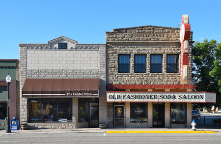 CODY, WYOMING - JUNE 24, 2017: The Center Store and Annies Old Fashioned Soda Saloon are toe businesses on Sheridan Avenue in Cody, Wyoming.