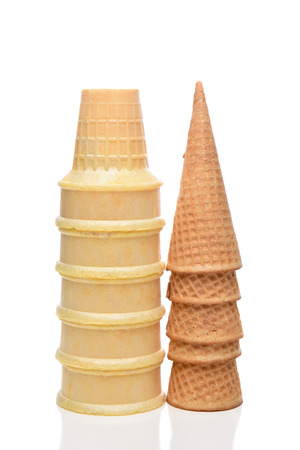 Two stacks of different Ice Cream Cones on white. Sugar cones and wafer of cake cones are represented. 스톡 콘텐츠