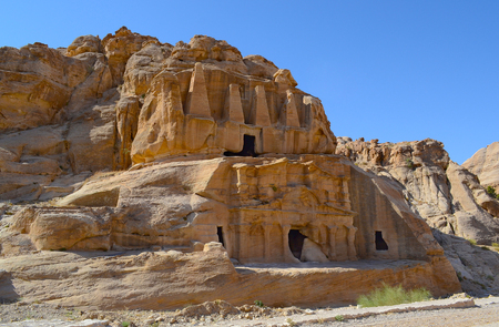 Ruins carved into the hillside rocks at Perta, Jordan, Stock Photo