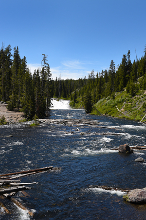 Lewis Falls are located on the Lewis River in Yellowstone National Park, Wyoming Stock fotó