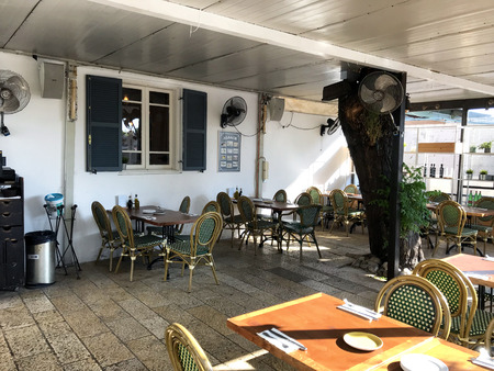 TEL AVIV, ISRAEL - MAY 15, 2018: Bellini Italian Restaurant outdoors seating. Bellini is located in Neve Tzedek, known for its cozy alleys reminiscent of Europe. Stock fotó - 110654078