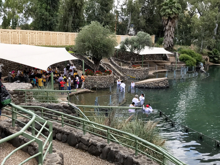 JORDAN VALLEY, ISRAEL - MAY 13, 2018: Yardenit Baptismal Site. On the banks of the Jordan River, tourists and pilgrims, come to be baptised in the same waters as Jesus. Editorial