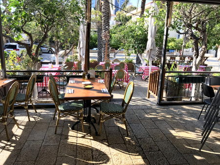 TEL AVIV, ISRAEL - MAY 15, 2018: Bellini Italian Restaurant outdoors seating. Bellini is located in Neve Tzedek, known for its cozy alleys reminiscent of Europe.