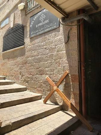 JERUSALEM - MAY 9, 2018: Cross on the Via Dolorosa at the Coptic Oorthodox Patriarchate, in the Christian Quarter of the Old City.