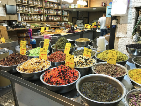 JERUSALEM - MAY 9, 2018: Mahane Yehuda Market Vendor. Popular with locals and tourists, the market has more than 250 vendors selling fresh fruit, vegetables, baked goods, fish, meat and more. Editöryel