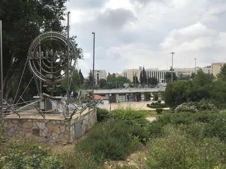 JERUSALEM - MAY 9, 2018: Menorah at Mount Herzl National Cemetery, with the museum in the background.