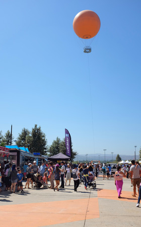 IRVINE, CALIFORNIA - SEPT 22, 2018: Food Trucks and the Balloon Ride at the Orange county Great Park during the Irvine Global Village annual Festival.