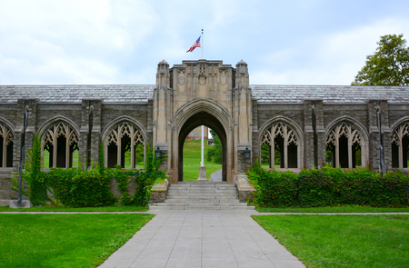 ITHACA, NEW YORK - SEPT 26, 2018: War Memorial at Cornell University, the cloister contains sixteen panels engraved with the names of students, alumni and faculty who died in World War I.