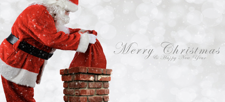 Santa Claus Placing Bag in Chimney - Banner size with Merry Christmas and Happy New Year. Bokeh Background with snow effect. Stock Photo
