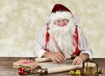 Santa Claus writing in his Naughty and Nice list with a candle and flame, presents, and ornaments