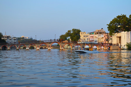 UDAIPUR, INDIA - November 4, 2015: Pedestrian Bridge in the old city seen from the Lake Pichola. Editorial