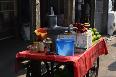 NEW DELHI, INDIA - OCTOBER 28, 2015: Street vendor juice cart on the sidewalk in New Delhi, India.