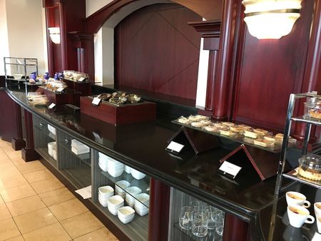 QUITO, ECUADOR - FEBRUARY 22, 2017: JW Marriott Quito Executive Lounge refreshment bar. The luxury hotel features tropical gardens in Quitos financial and entertainment district.