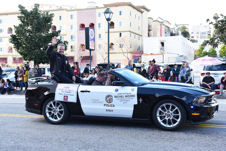 LOS ANGELES - FEBRUARY 9, 2019: LAPD Chief  of Police Michel Moore rides in the Chinese New Year Parade.